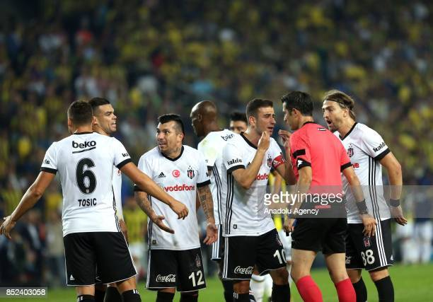 Oguzhan Ozyakup Tosic and Gary Alexis Medel of Besiktas react to the referee during the Turkish Super Lig week 6 soccer match between Fenerbahce and...