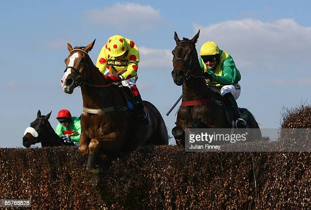 Oh Crick ridden by jockey Robert Thornton jumps the last and goes onto to win ahead of Lord Jay Jay ridden by jockey Liam Treadwell in the John...