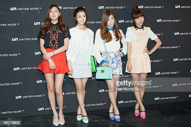 Oh HaYoung Yoon BoMi Park ChoRong and Kim NamJoo of South Korean girl group A Pink pose for media the 'United Nude' flagship store opening at United...