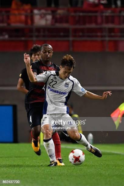 Oh Jae Suk of Gamba Osaka controls the ball under pressure of Leo Silva of Kashima Antlers during the JLeague J1 match between Kashima Antlers and...