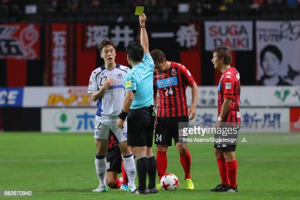 Oh Jae Suk of Gamba Osaka is shown a yellow card by referee Koichiro Fukushima during the JLeague J1 match between Consadole Sapporo and Gamba Osaka...
