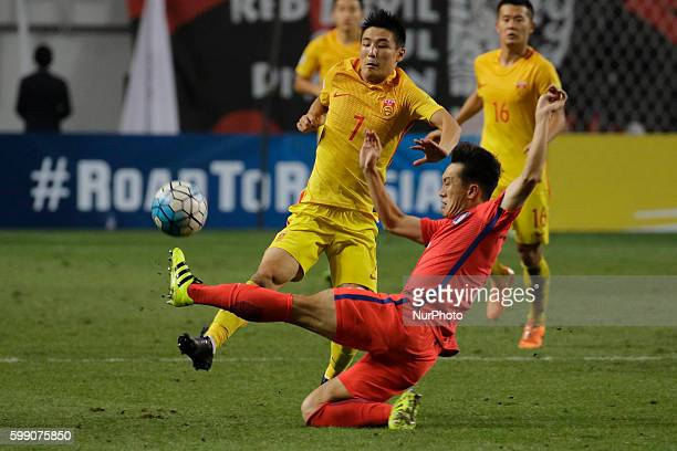 Oh Jae Suk of South Korea and Wu Lei of China action during an 2018 Russia World Cup Asia Qualifiers South Korea V China match at World Cup Stadium...