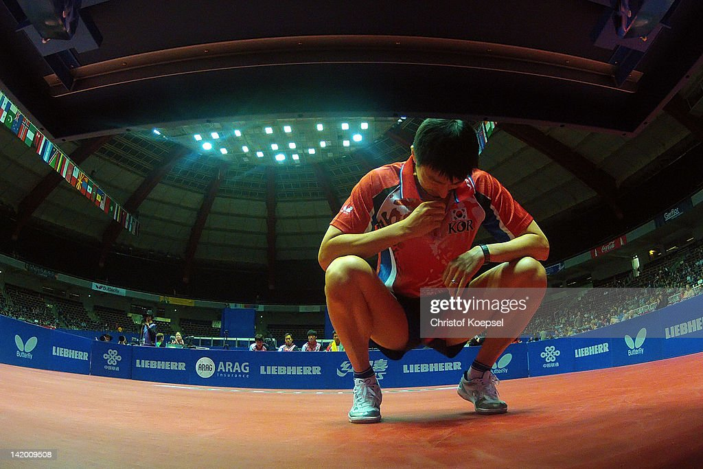 <a gi-track='captionPersonalityLinkClicked' href=/galleries/search?phrase=Oh+Sang+Eun&family=editorial&specificpeople=658495 ng-click='$event.stopPropagation()'>Oh Sang Eun</a> of South Korea during a break during his match against Daniel Habesohn of Austria during the LIEBHERR table tennis team world cup 2012 championship division group C men's team match between South Korea and Austria at Westfalenhalle Dortmund on March 28, 2012 in Dortmund, Germany. South Korea won 3-1 against Austria.