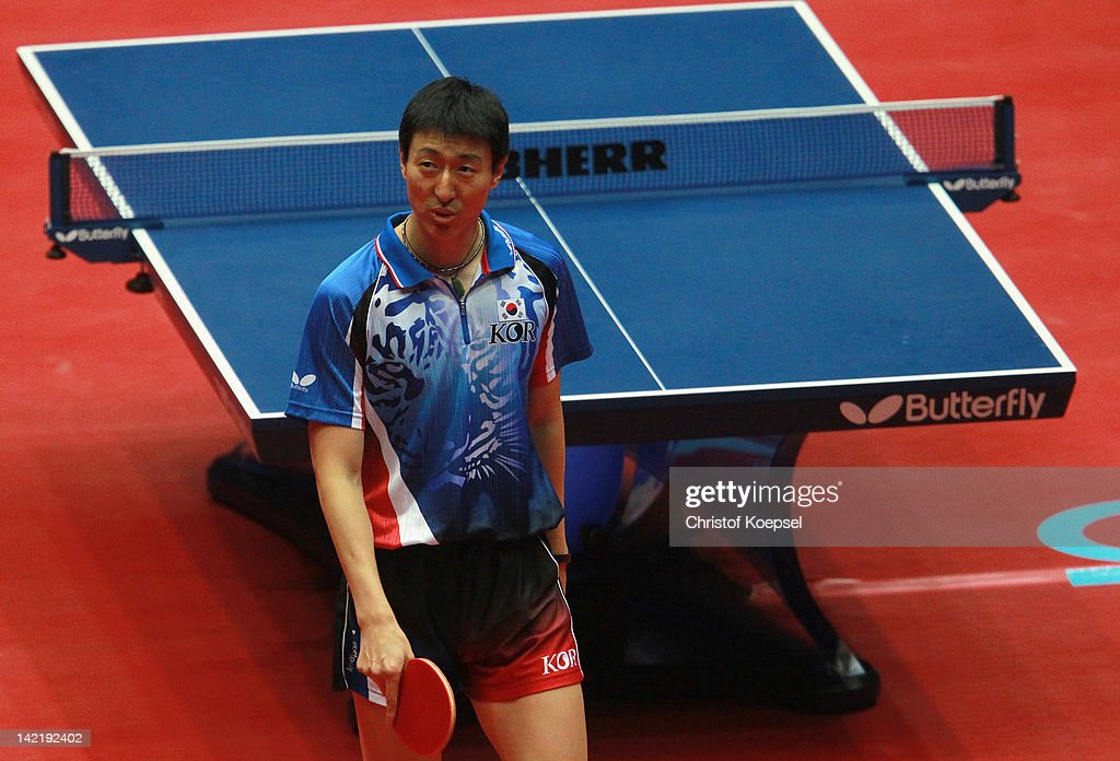 <a gi-track='captionPersonalityLinkClicked' href=/galleries/search?phrase=Oh+Sang+Eun&family=editorial&specificpeople=658495 ng-click='$event.stopPropagation()'>Oh Sang Eun</a> of South Korea looks dejected after losing against Ma Long of China during the LIEBHERR table tennis team world cup 2012 championship division men's semi -final match between China and South Korea at Westfalenhalle on March 31, 2012 in Dortmund, Germany.