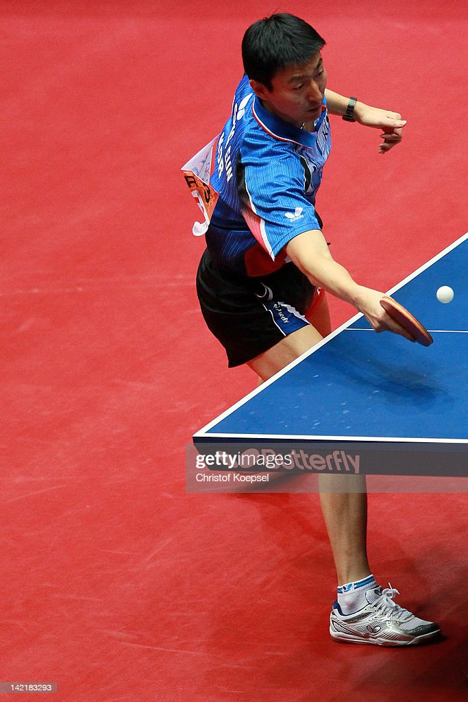 <a gi-track='captionPersonalityLinkClicked' href=/galleries/search?phrase=Oh+Sang+Eun&family=editorial&specificpeople=658495 ng-click='$event.stopPropagation()'>Oh Sang Eun</a> of South Korea plays a forehand during his match gainst <a gi-track='captionPersonalityLinkClicked' href=/galleries/search?phrase=Ma+Long&family=editorial&specificpeople=2158981 ng-click='$event.stopPropagation()'>Ma Long</a> of China during his match against <a gi-track='captionPersonalityLinkClicked' href=/galleries/search?phrase=Oh+Sang+Eun&family=editorial&specificpeople=658495 ng-click='$event.stopPropagation()'>Oh Sang Eun</a> of South Korea during the LIEBHERR table tennis team world cup 2012 championship division men's semi -final match between China and South Korea at Westfalenhalle on March 31, 2012 in Dortmund, Germany.