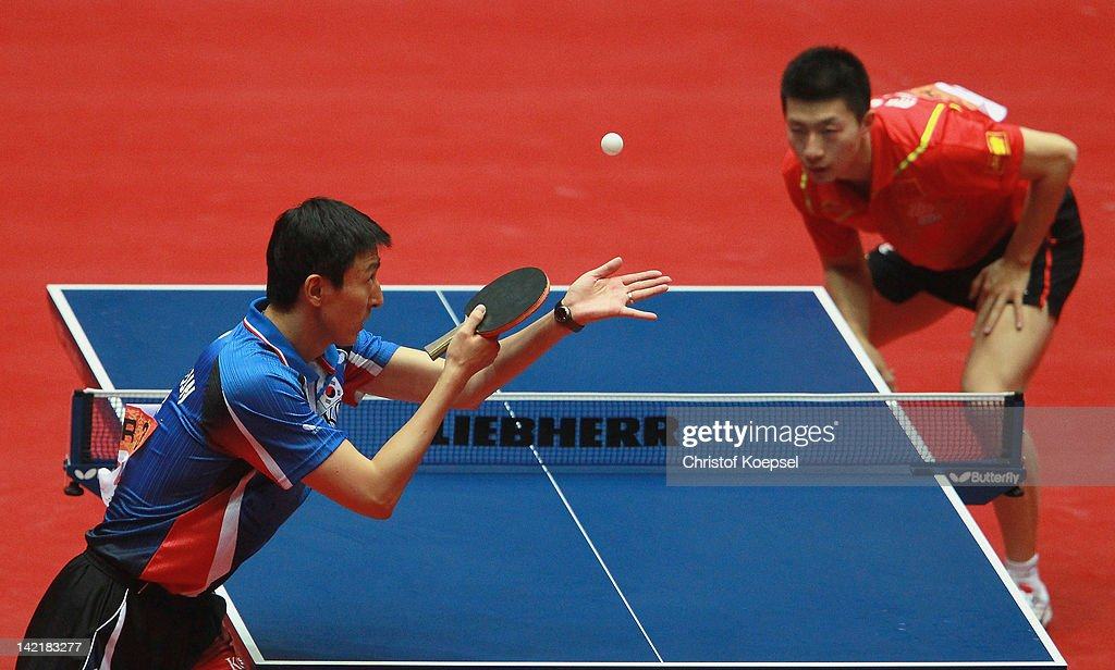 <a gi-track='captionPersonalityLinkClicked' href=/galleries/search?phrase=Oh+Sang+Eun&family=editorial&specificpeople=658495 ng-click='$event.stopPropagation()'>Oh Sang Eun</a> of South Korea serves during his match gainst <a gi-track='captionPersonalityLinkClicked' href=/galleries/search?phrase=Ma+Long&family=editorial&specificpeople=2158981 ng-click='$event.stopPropagation()'>Ma Long</a> of China during his match against <a gi-track='captionPersonalityLinkClicked' href=/galleries/search?phrase=Oh+Sang+Eun&family=editorial&specificpeople=658495 ng-click='$event.stopPropagation()'>Oh Sang Eun</a> of South Korea during the LIEBHERR table tennis team world cup 2012 championship division men's semi -final match between China and South Korea at Westfalenhalle on March 31, 2012 in Dortmund, Germany.