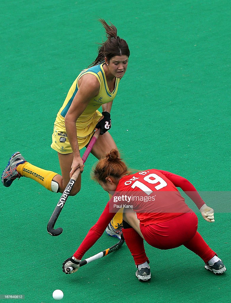Oh Sunsoon of Korea blocks Anna Flanagan of Australia during the International Test match between the Australian Hockeyroos and Korea at Perth Hockey Stadium on April 27, 2013 in Perth, Australia.