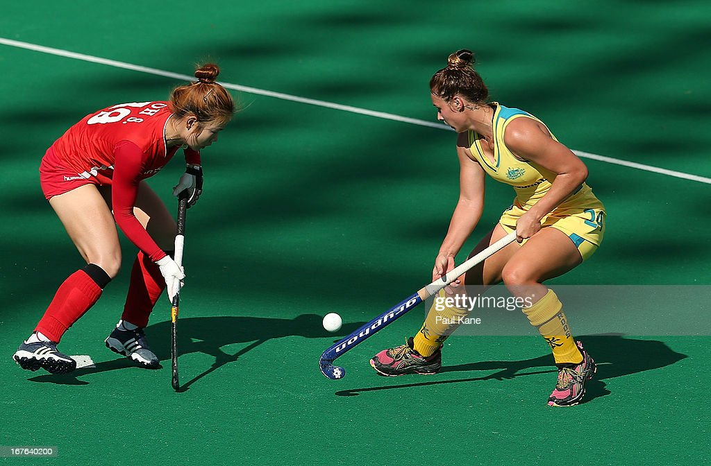 Oh Sunsoon of Korea is challenged by Mariah Williams of Australia during the International Test match between the Australian Hockeyroos and Korea at Perth Hockey Stadium on April 27, 2013 in Perth, Australia.