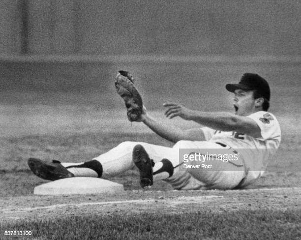 Oh The Indignation of it all Firstbaseman Jim Mooring of the Denver Bears not finds himself on the seat of his pants but also hears the umpire yell...