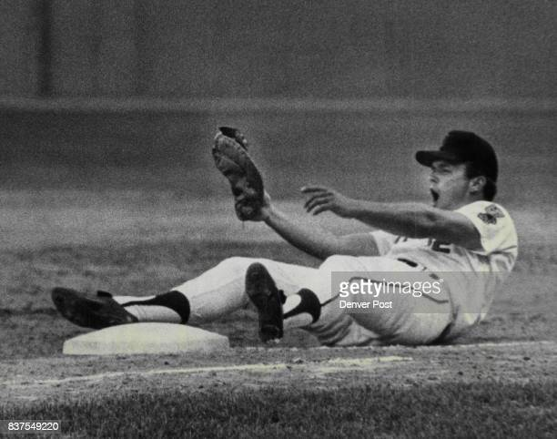 Oh The Indignation Of It All Firstbaseman Jim Mooring of the DenverBears not only finds himself on the seat of his pants but also hears the umpire...