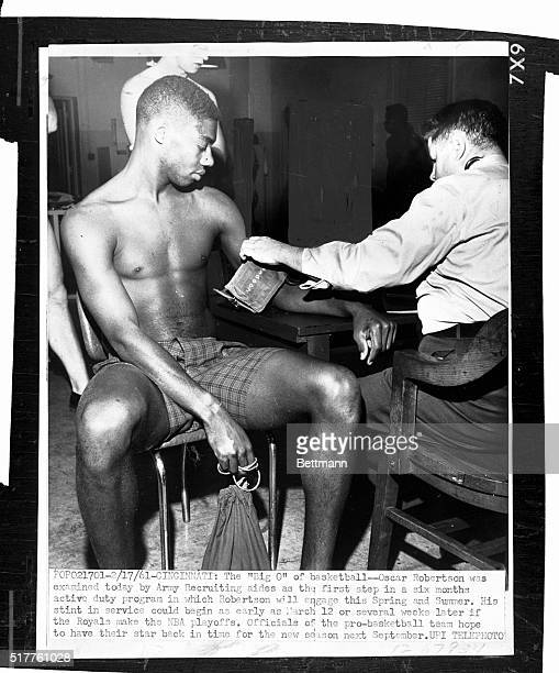 Ohio basketball star Oscar Robertson is examined Feb 17 at an army recruiting station as the first step in a six month active duty program...