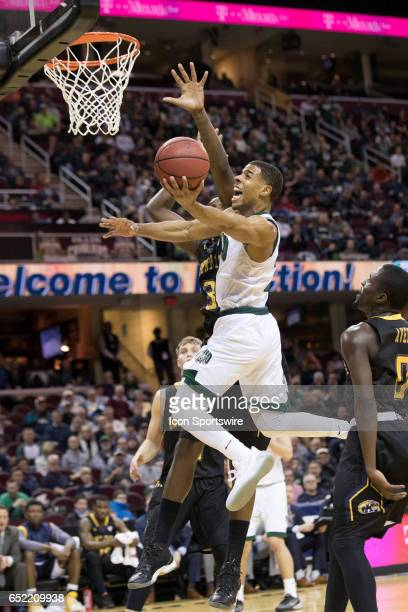Ohio Bobcats G Jaaron Simmons drives to the basket as Kent State Golden Flashes F Jimmy Hall defends during the first half of the MAC mens basketball...