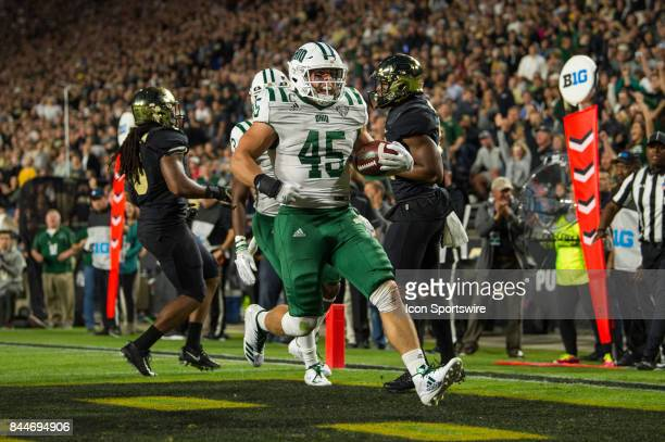 Ohio Bobcats running back AJ Ouellette runs in the end zone for a 4yard touchdown during the college football game between the Purdue Boilermakers...