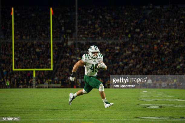 Ohio Bobcats running back AJ Ouellette runs to the outside for a 4yard touchdown during the college football game between the Purdue Boilermakers and...