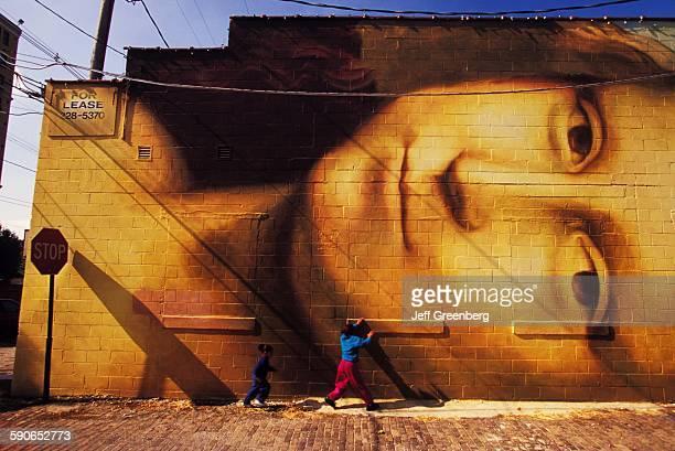 Ohio Columbus Young Children Under Mona Lisa Mural In Short North Neighborhood