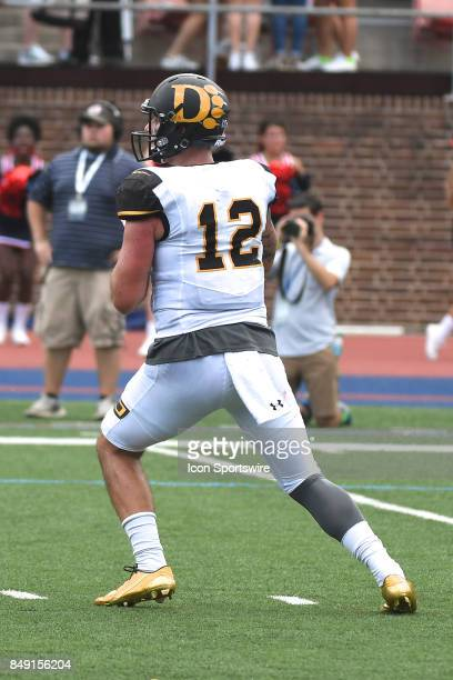 Ohio Dominican Panthers quarterback Grant Russell drops back to pass during a college football game between the Penn Quakers and the Ohio Dominican...