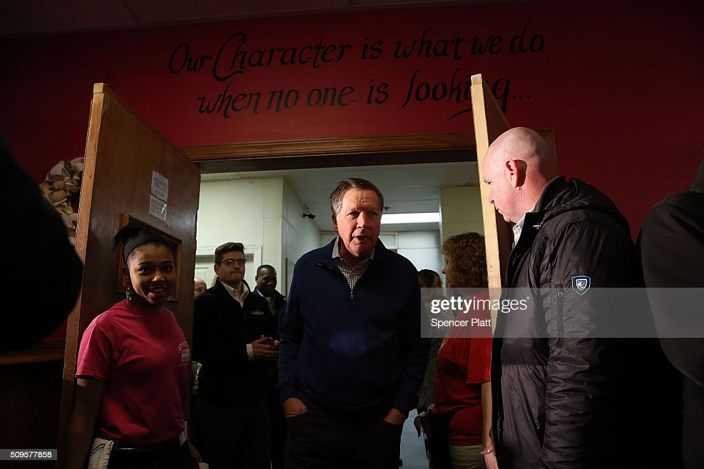 Ohio Governor and Republican presidential candidate <a gi-track='captionPersonalityLinkClicked' href=/galleries/search?phrase=John+Kasich&family=editorial&specificpeople=1315571 ng-click='$event.stopPropagation()'>John Kasich</a> enters a restaurant in South Carolina following his second place showing in the New Hampshire primary on February 11, 2016 in Pawleys Island, South Carolina. Kasich, who is running as a moderate, is expected to face a difficult environment in South Carolina where conservative voters far outnumber moderates.