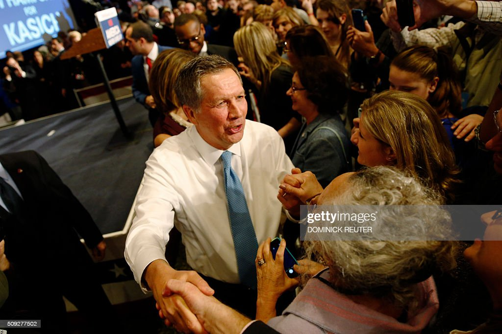 Ohio Governor and Republican presidential candidate John Kasich greets supporters at a primary election watch party after finishing second to Donald...
