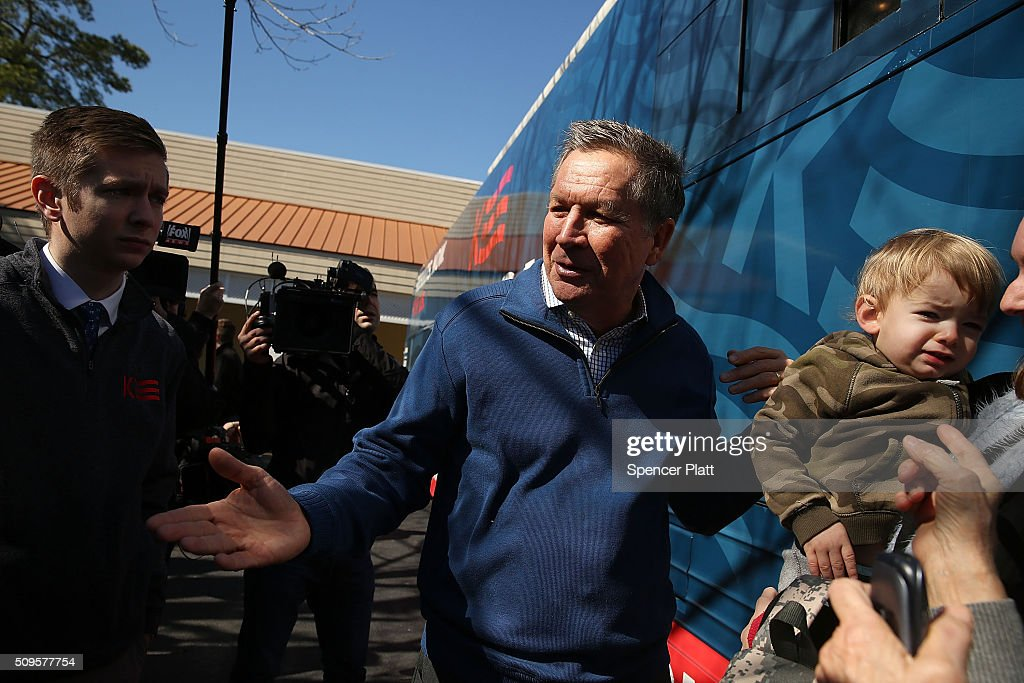 Ohio Governor and Republican presidential candidate <a gi-track='captionPersonalityLinkClicked' href=/galleries/search?phrase=John+Kasich&family=editorial&specificpeople=1315571 ng-click='$event.stopPropagation()'>John Kasich</a> gets on his bus after speaking to voters inside of a restaurant in South Carolina following his second place showing in the New Hampshire primary on February 11, 2016 in Pawleys Island, South Carolina. Kasich, who is running as a moderate, is expected to face a difficult environment in South Carolina where conservative voters far outnumber moderates.