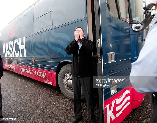 Ohio Governor and Republican Presidential Candidate John Kasich jokes around as he arrives at a Town Hall meeting he was hosting February 16 2016 in...