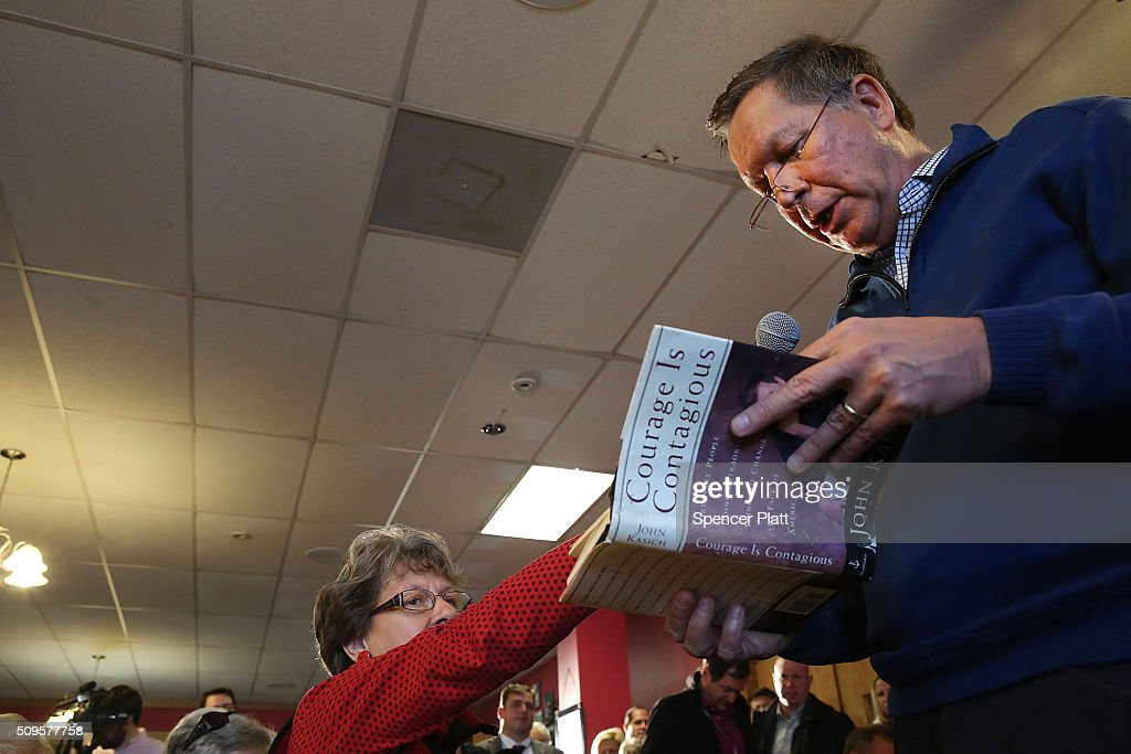 Ohio Governor and Republican presidential candidate <a gi-track='captionPersonalityLinkClicked' href=/galleries/search?phrase=John+Kasich&family=editorial&specificpeople=1315571 ng-click='$event.stopPropagation()'>John Kasich</a> reads from one of his books as he speaks to voters inside of a restaurant in South Carolina following his second place showing in the New Hampshire primary on February 11, 2016 in Pawleys Island, South Carolina. Kasich, who is running as a moderate, is expected to face a difficult environment in South Carolina where conservative voters far outnumber moderates.
