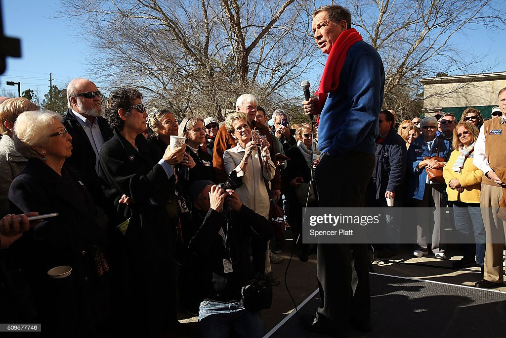 Ohio Governor and Republican presidential candidate <a gi-track='captionPersonalityLinkClicked' href=/galleries/search?phrase=John+Kasich&family=editorial&specificpeople=1315571 ng-click='$event.stopPropagation()'>John Kasich</a> speaks to voters outside of a restaurant in South Carolina following his second place showing in the New Hampshire primary on February 11, 2016 in Pawleys Island, South Carolina. Kasich, who is running as a moderate, is expected to face a difficult environment in South Carolina where conservative voters far outnumber moderates.