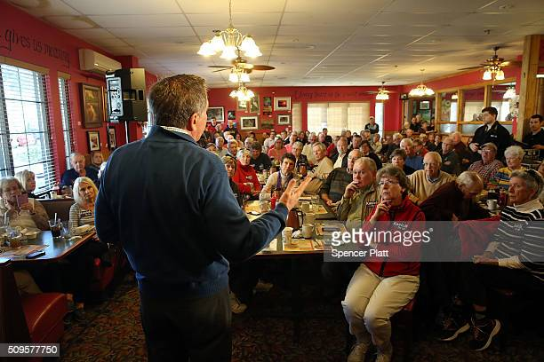 Ohio Governor and Republican presidential candidate John Kasich speaks to voters inside of a restaurant in South Carolina following his second place...