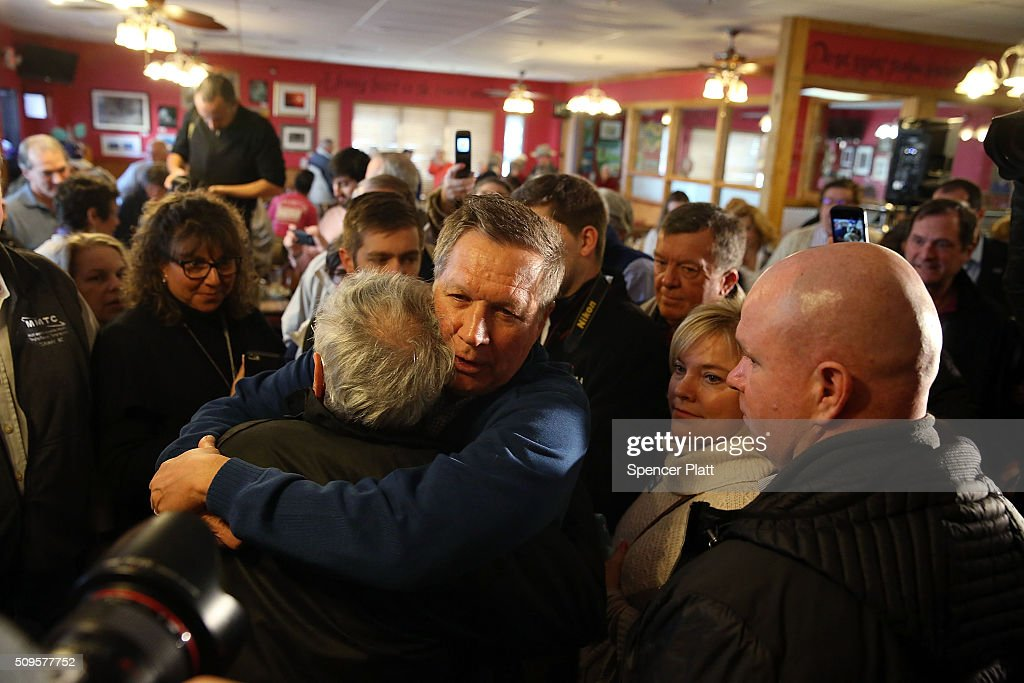 Ohio Governor and Republican presidential candidate <a gi-track='captionPersonalityLinkClicked' href=/galleries/search?phrase=John+Kasich&family=editorial&specificpeople=1315571 ng-click='$event.stopPropagation()'>John Kasich</a> speaks to voters inside of a restaurant in South Carolina following his second place showing in the New Hampshire primary on February 11, 2016 in Pawleys Island, South Carolina. Kasich, who is running as a moderate, is expected to face a difficult environment in South Carolina where conservative voters far outnumber moderates.