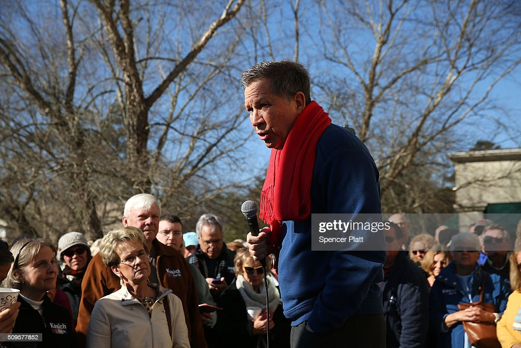 Ohio Governor and Republican presidential candidate John Kasich speaks to voters outside of a restaurant in South Carolina following his second place showing in the New Hampshire primary on February 11, 2016 in Pawleys Island, South Carolina. Kasich, who is running as a moderate, is expected to face a difficult environment in South Carolina where conservative voters far outnumber moderates.