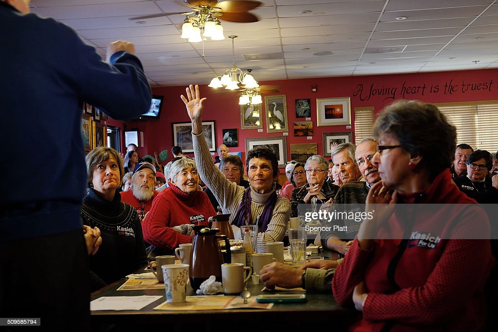 Ohio Governor and Republican presidential candidate John Kasich speaks to voters inside of a restaurant in South Carolina following his second place showing in the New Hampshire primary on February 11, 2016 in Pawleys Island, South Carolina. Kasich, who is running as a moderate, is expected to face a difficult environment in South Carolina where conservative voters far outnumber moderates.