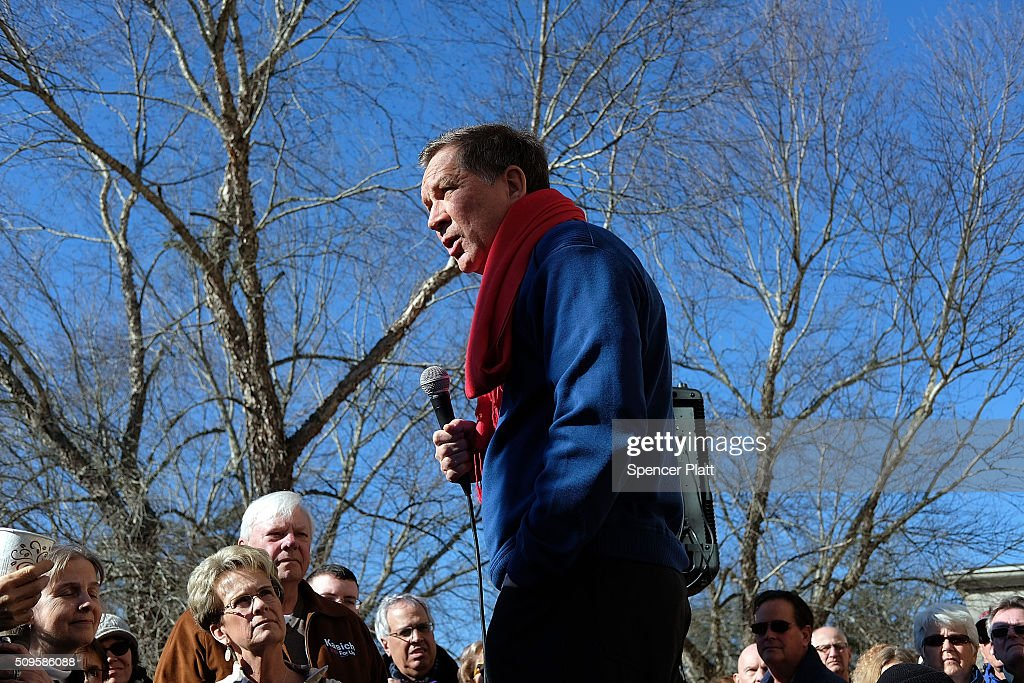Ohio Governor and Republican presidential candidate John Kasich speaks to voters outside of a restaurant in South Carolina following his second place showing in the New Hampshire primary on February 11, 2016 in Pawleys Island, South Carolina. Kasich, who is running as a moderate, is expected to face a difficult environment in South Carolina where conservative voters traditionally outnumber moderates.