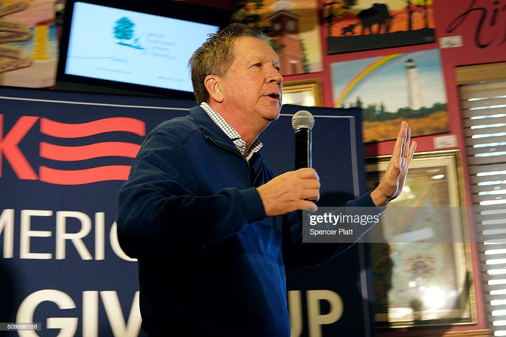Ohio Governor and Republican presidential candidate <a gi-track='captionPersonalityLinkClicked' href=/galleries/search?phrase=John+Kasich&family=editorial&specificpeople=1315571 ng-click='$event.stopPropagation()'>John Kasich</a> speaks to voters inside of a restaurant in South Carolina following his second place showing in the New Hampshire primary on February 11, 2016 in Pawleys Island, South Carolina. Kasich, who is running as a moderate, is expected to face a difficult environment in South Carolina where conservative voters traditionally outnumber moderates.