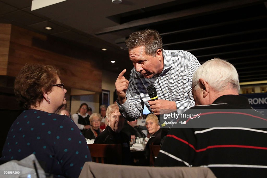 Ohio Governor and Republican presidential candidate John Kasich speaks to voters at a restaurant in South Carolina following his second place showing in the New Hampshire primary on February 11, 2016 in Myrtle Beach South Carolina. Kasich, who is running as a moderate, is expected to face a difficult environment in South Carolina where conservative voters traditionally outnumber moderates.