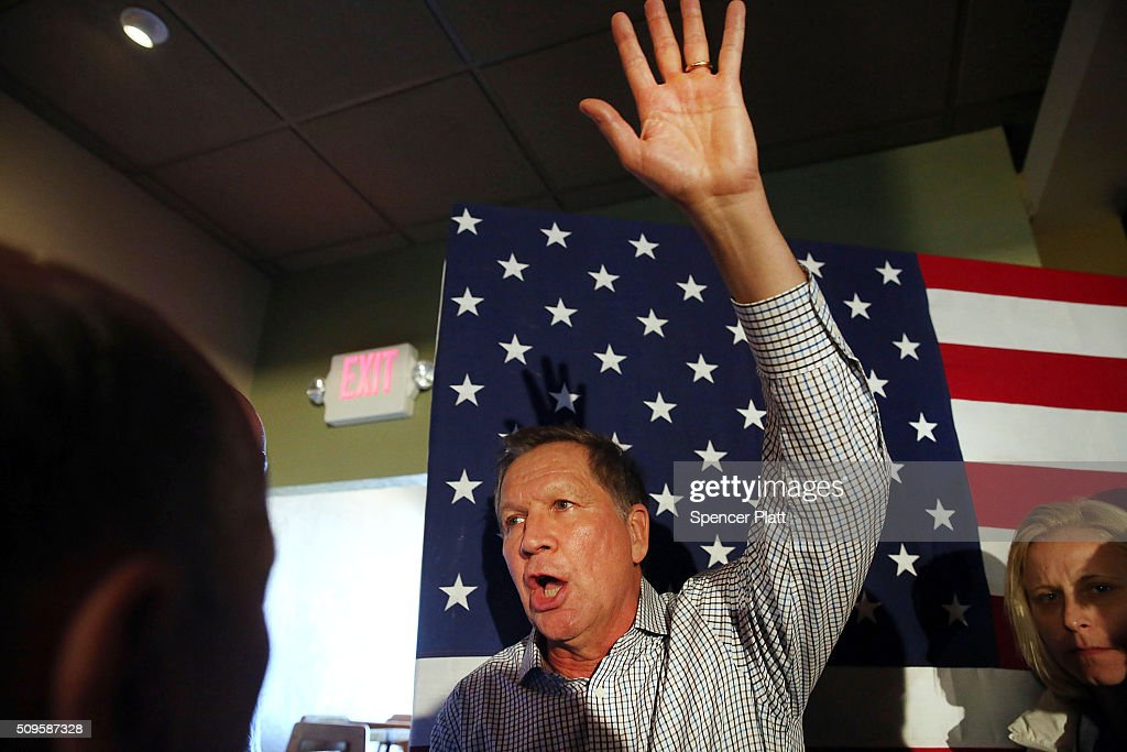 Ohio Governor and Republican presidential candidate <a gi-track='captionPersonalityLinkClicked' href=/galleries/search?phrase=John+Kasich&family=editorial&specificpeople=1315571 ng-click='$event.stopPropagation()'>John Kasich</a> speaks to voters at a restaurant in South Carolina following his second place showing in the New Hampshire primary on February 11, 2016 in Myrtle Beach South Carolina. Kasich, who is running as a moderate, is expected to face a difficult environment in South Carolina where conservative voters traditionally outnumber moderates.