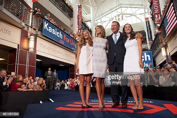 Ohio Governor John Kasich stands with his wife Karen and his daughters Emma and Reese after giving his speech announcing his 2016 Presidential...