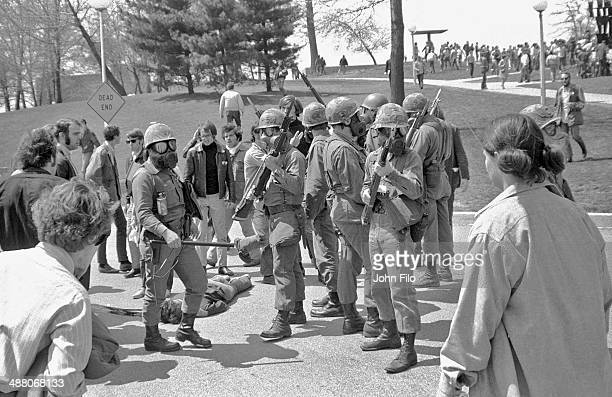 Ohio National Guard troops and demonstrators stand near the body of student Jeffrey Miller who was shot and killed by guardsmen during an antiwar...