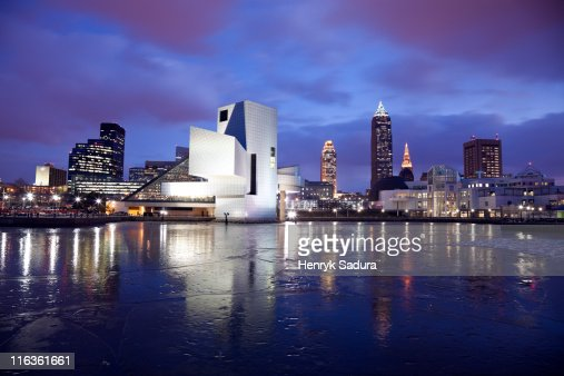 USA, Ohio, Rock and Roll Hall of Fame and Museum across frozen lake at dusk