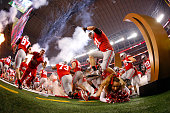 Ohio State Buckeyes cheerleader falls as the Buckeyes run out to the field before the College Football Playoff National Championship Game at ATT...