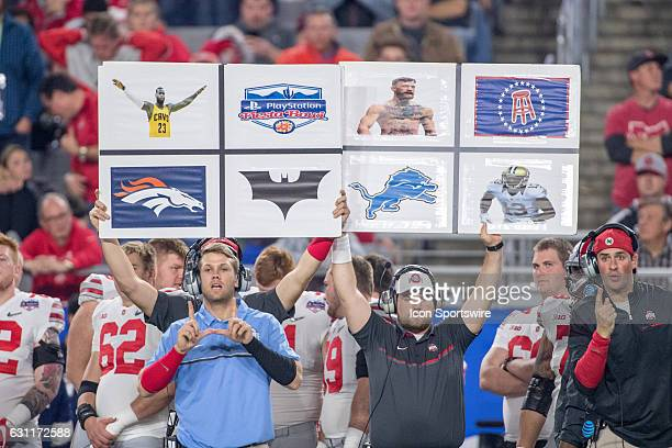 Ohio State Buckeyes coaches call a play with signs during the first half of the 2016 PlayStation Fiesta Bowl against the Clemson Tigers at University...