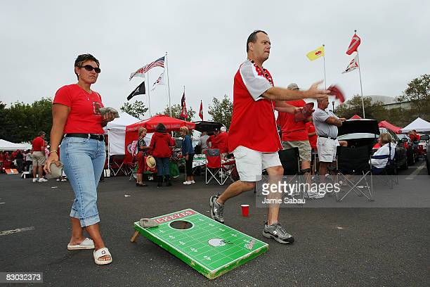 Ohio State Buckeyes fans play a game of cornhole in a parking lot outside Ohio Stadium before their game against the Minnesota Golden Gophers on...