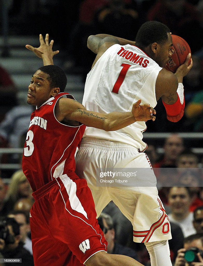 Ohio State Buckeyes forward Deshaun Thomas (1) gets a pass in front of Wisconsin Badgers guard George Marshall (3) during the first half in the finals of the men's Big Ten basketball tournament at the United Center in Chicago, Illinois, Sunday, March 17, 2013. Buckeyes win, 50-43.