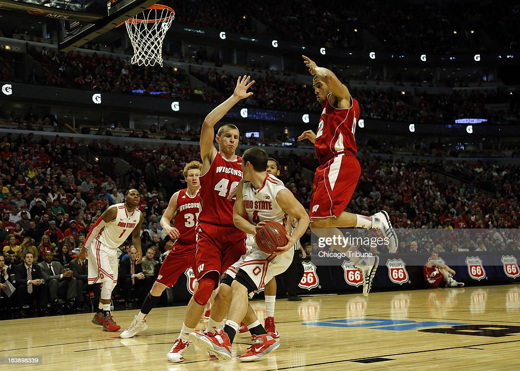 Ohio State Buckeyes guard Aaron Craft (4) is surrounded by Wisconsin Badgers forward/center Jared Berggren (40) and Wisconsin Badgers guard Traevon Jackson (12) during the second half in the finals of the men's Big Ten basketball tournament at the United Center in Chicago, Illinois, Sunday, March 17, 2013. Buckeyes win, 50-43.