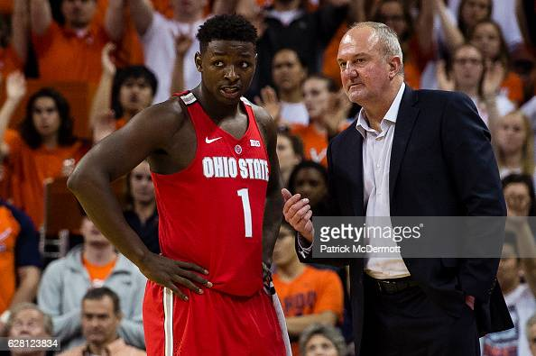 Ohio State Buckeyes head coach Thad Matta talks with Jae'Sean Tate of the Ohio State Buckeyes during the second half of a game against the Virginia...