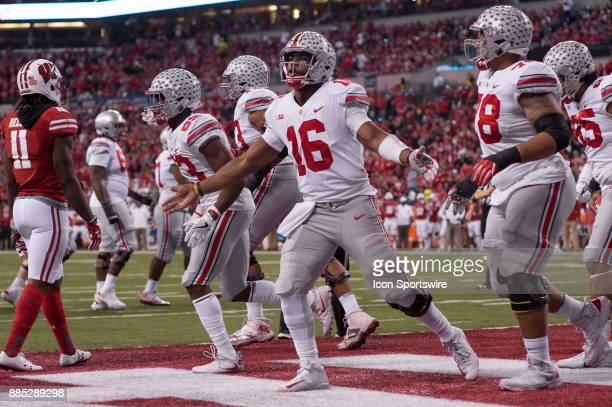 Ohio State Buckeyes quarterback JT Barrett celebrates a touchdown run during the Big 10 Championship game between the Wisconsin Badgers and Ohio...
