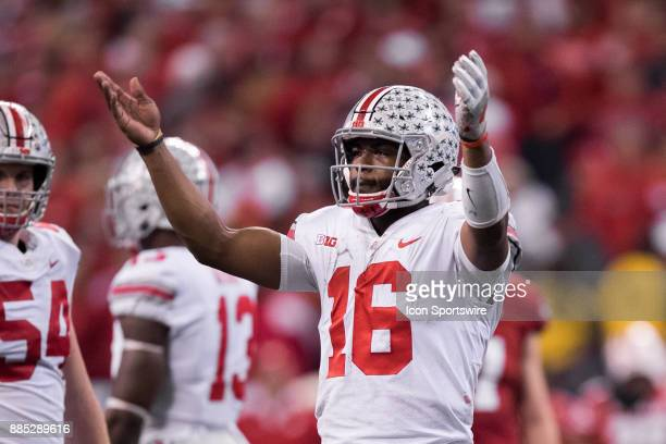 Ohio State Buckeyes quarterback JT Barrett celebrates with the fans during the Big 10 Championship game between the Wisconsin Badgers and Ohio State...