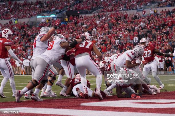 Ohio State Buckeyes quarterback JT Barrett dives in for a 1 yard touchdown during the Big 10 Championship game between the Wisconsin Badgers and Ohio...
