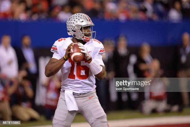 Ohio State Buckeyes quarterback JT Barrett drops back for a pass during the Big Ten Championship Game between the Ohio State Buckeyes and the...