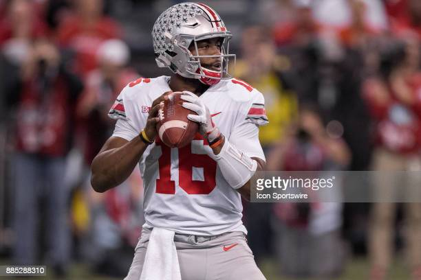 Ohio State Buckeyes quarterback JT Barrett looks downfield during the Big 10 Championship game between the Wisconsin Badgers and Ohio State Buckeyes...