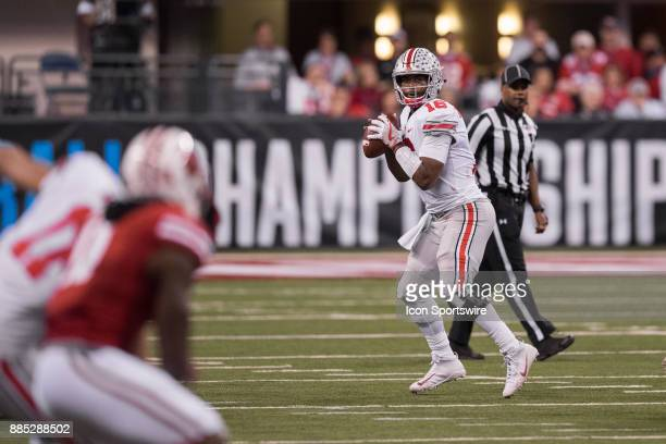 Ohio State Buckeyes quarterback JT Barrett looks downfield for a open receiver during the Big 10 Championship game between the Wisconsin Badgers and...