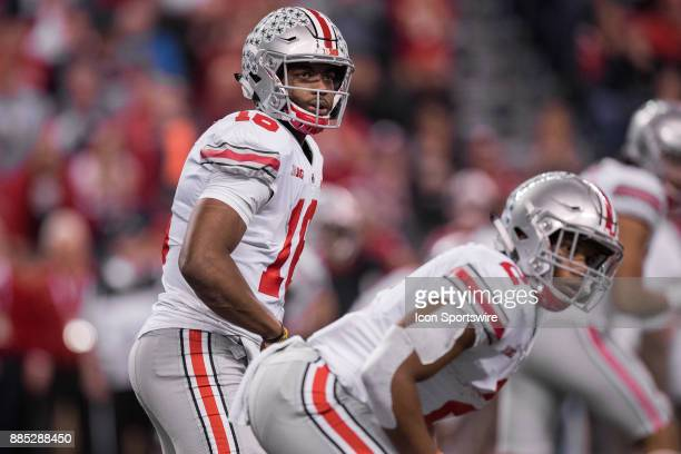 Ohio State Buckeyes quarterback JT Barrett looks over to the sidelines for the play call during the Big 10 Championship game between the Wisconsin...